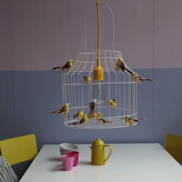 yellow pendant light birds