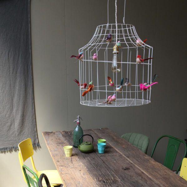 birds pendant light above dining table